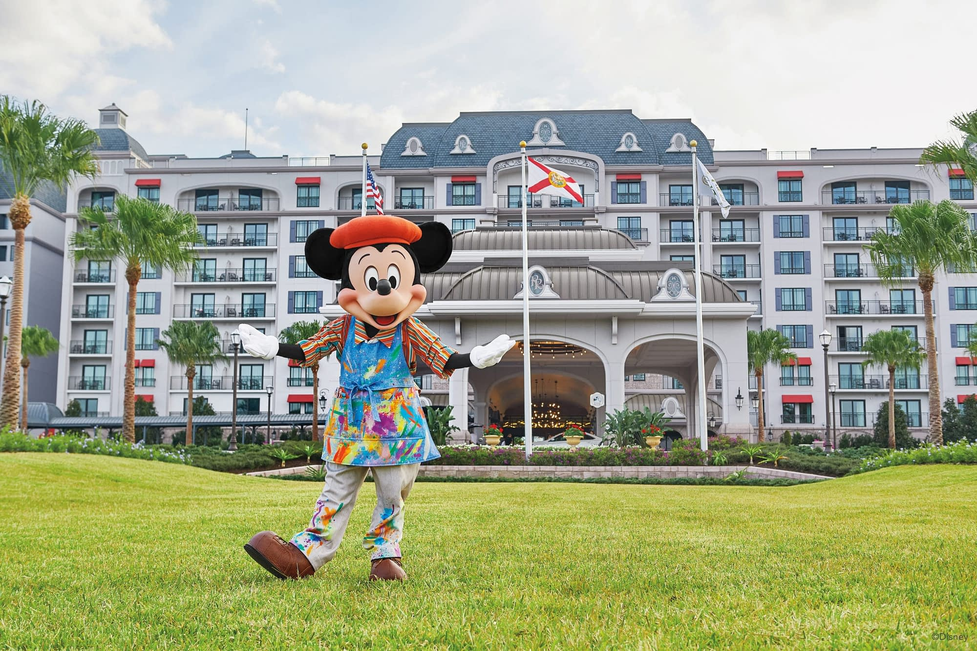 Painter Mickey Mouse in front of Disney's Riviera Resort.