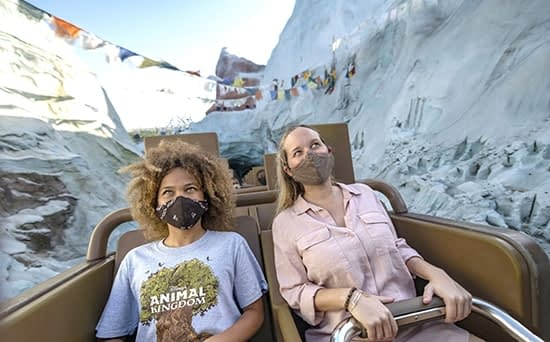 Two ladies with masks on Everest Expedition rollercoaster at Disney's Animal Kingdom Theme Park